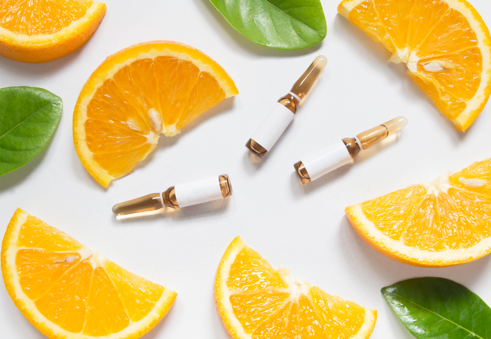 orange slices and ampoules respresenting immunity boost IV Therapy