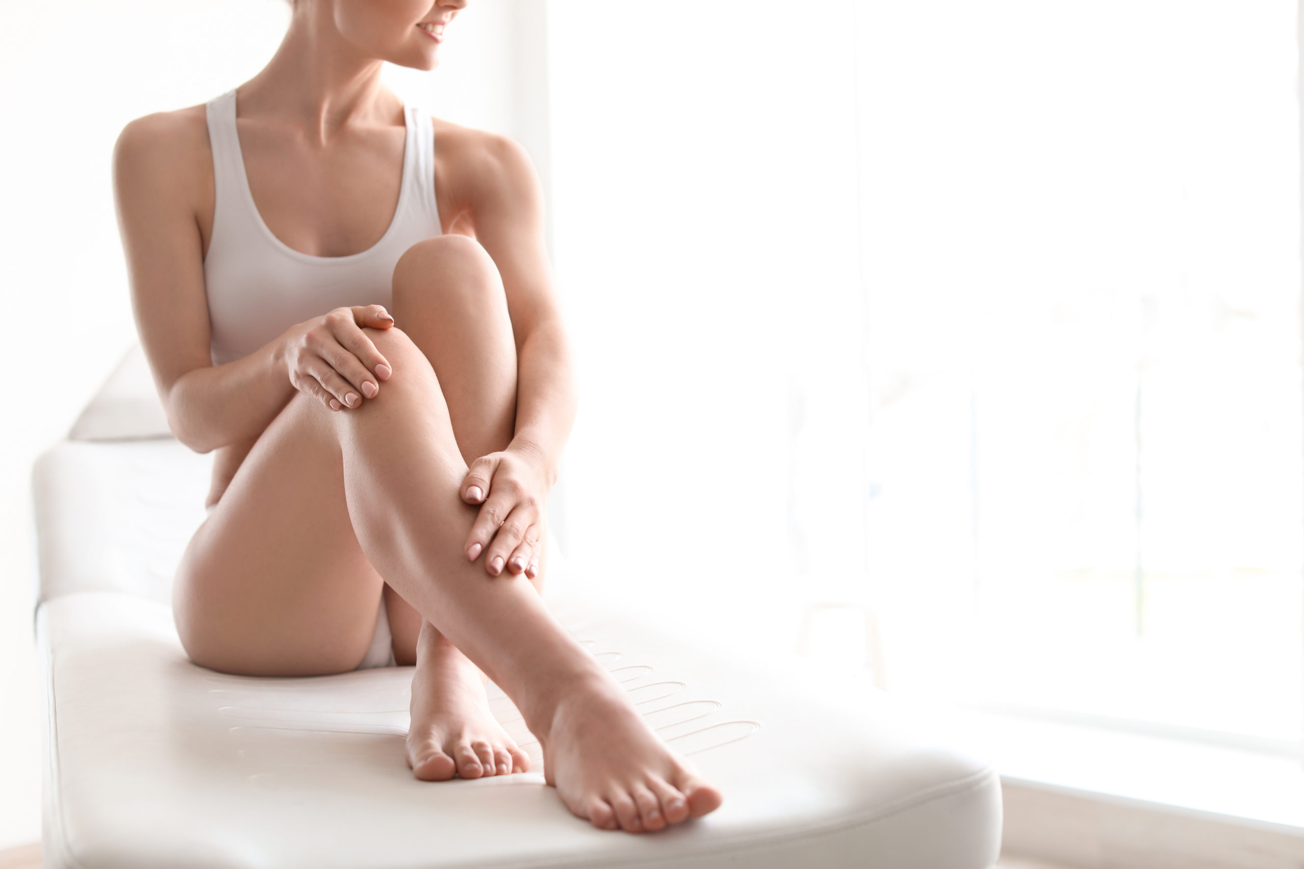 seated woman with smooth skin from laser hair removal