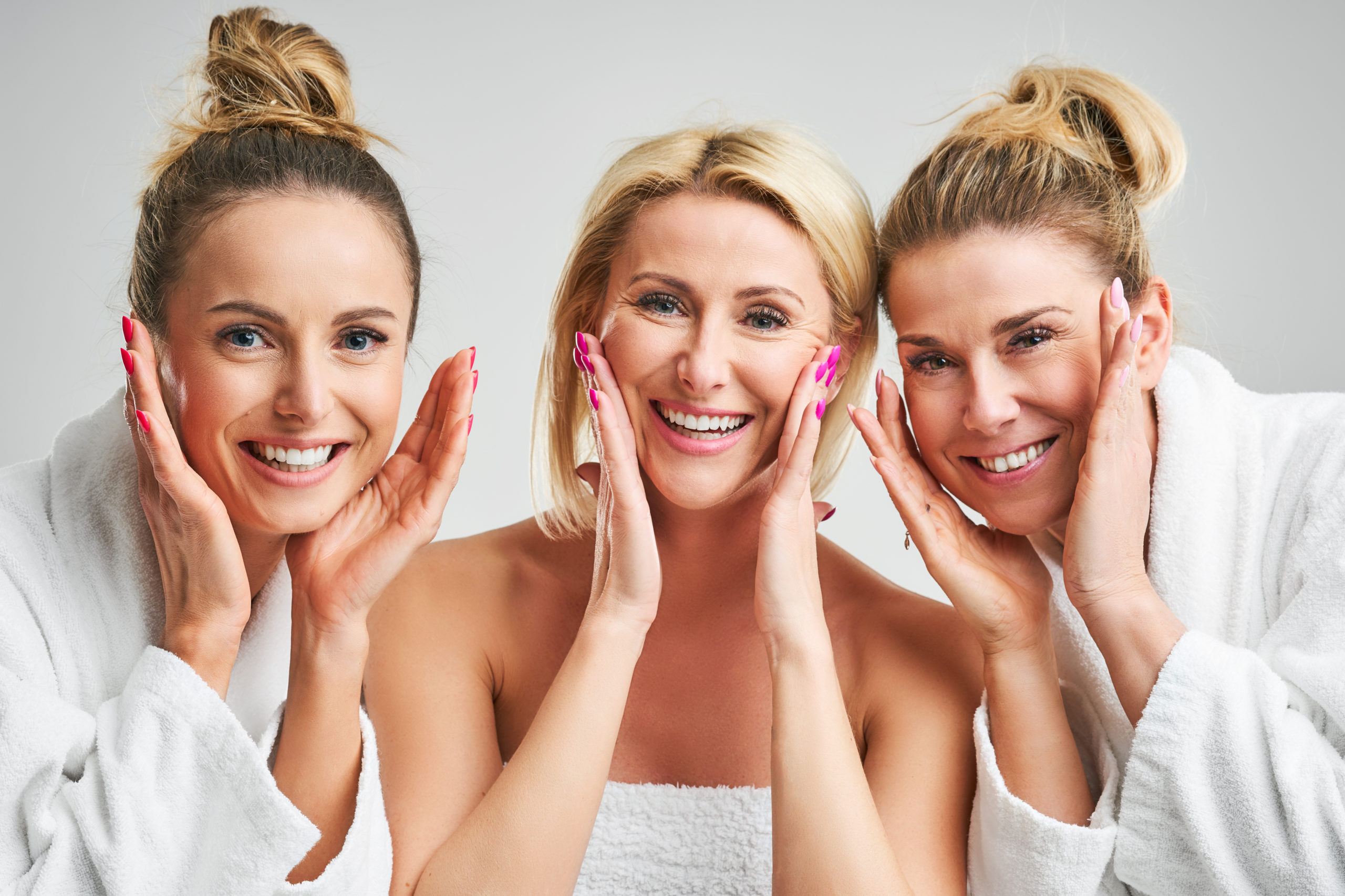 three happy women of different ages after microneedling