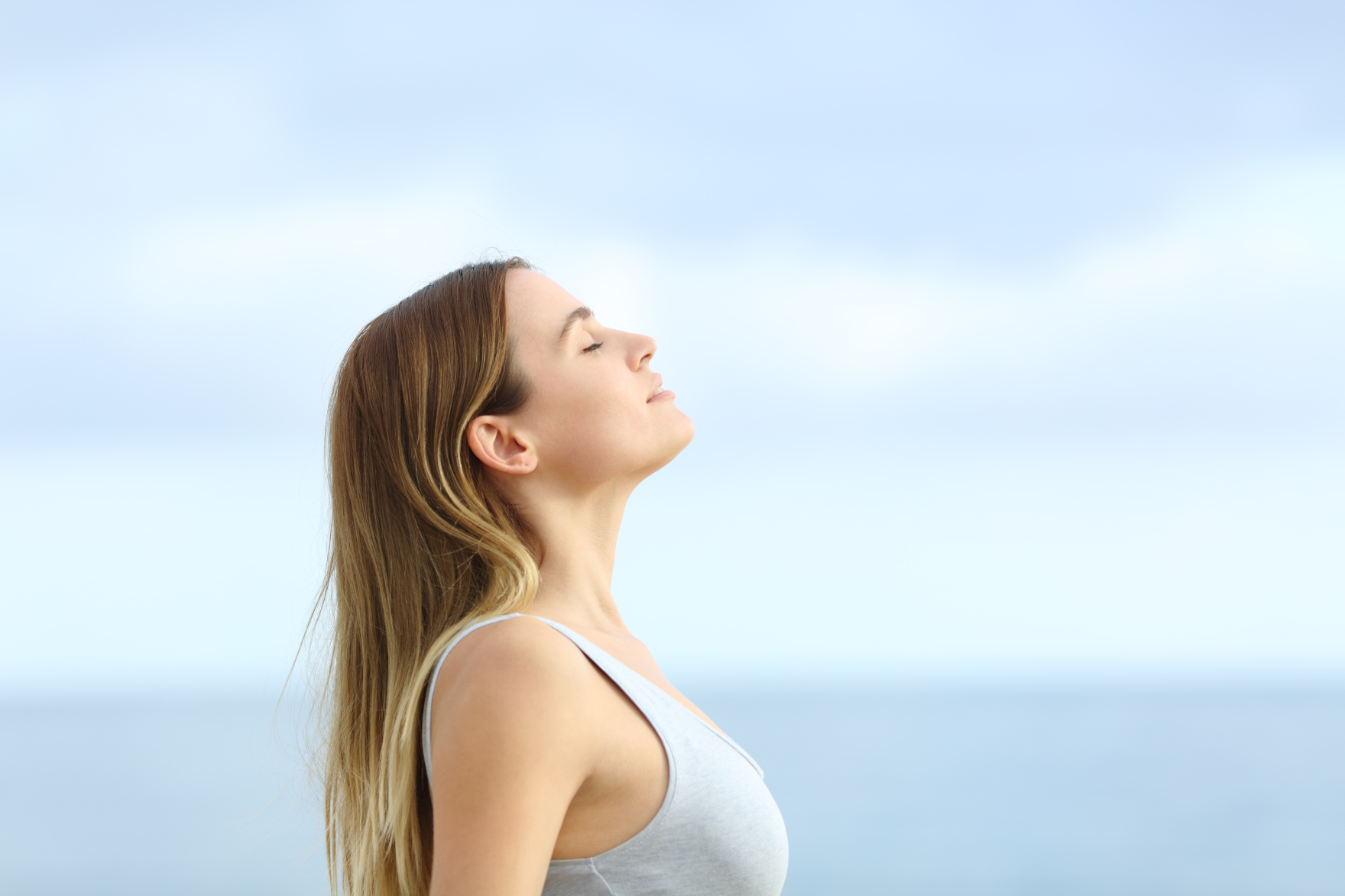 profile of woman relaxing outdoors after IV Therapy